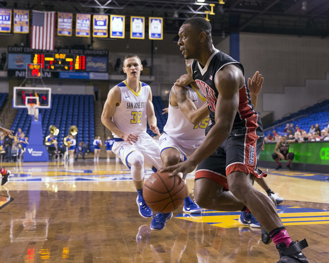 Jan 28, 2017; San Jose, CA, USA; UNLV Rebels forward Christian Jones (20) drives in against San Jose State Spartans forward Brandon Clarke (15) during the first half at San Jose State Event Center ...