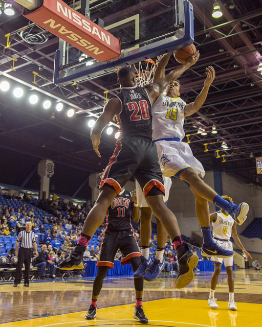 Jan 28, 2017; San Jose, CA, USA; San Jose State Spartans forward Brandon Clarke (15) goes up to block the shot by UNLV Rebels forward Christian Jones (20) during the first half at San Jose State E ...