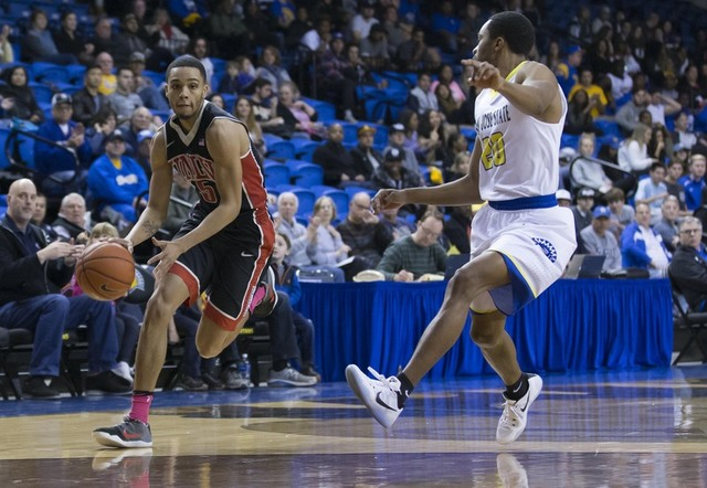 Jan 28, 2017; San Jose, CA, USA; UNLV Rebels guard Jalen Poyser (5) drives in against San Jose State Spartans guard Isaac Thornton (20) during the first half at San Jose State Event Center. (Nevil ...
