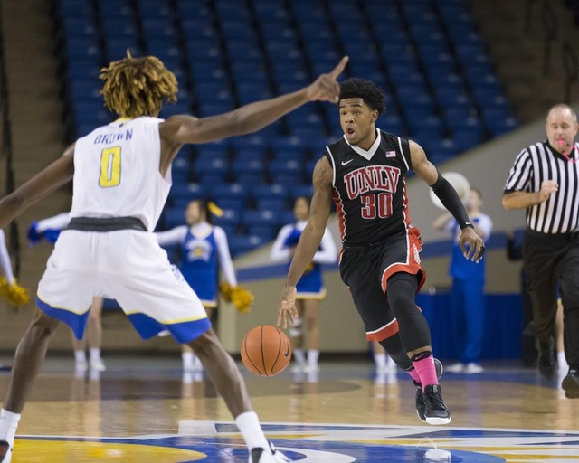 Jan 28, 2017; San Jose, CA, USA; UNLV Rebels guard Jovan Mooring (30) dribbles the basketball against San Jose State Spartans guard Terrell Brown (0) during the first half at San Jose State Event  ...