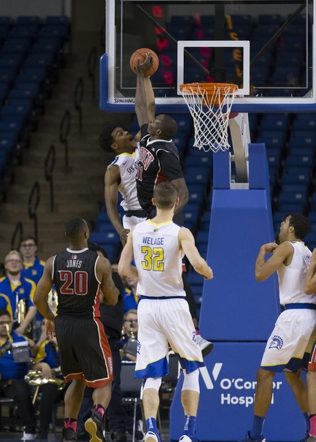 Jan 28, 2017; San Jose, CA, USA; UNLV Rebels forward Cheickna Dembele (11) goes up to block the shot by San Jose State Spartans guard Jaycee Hillsman (25) during the first half at San Jose State E ...