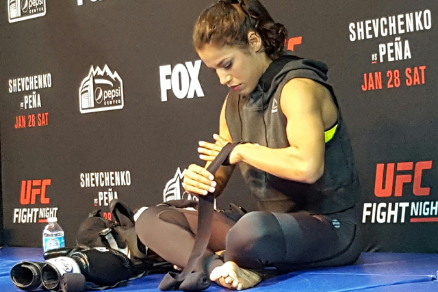 UFC women's bantamweight contender Julianna Pena wraps her hands Thursday before open workouts at EXDO Event Center in Denver in advance of her UFC on Fox 23 bout against Valentina Shevchenko on S ...