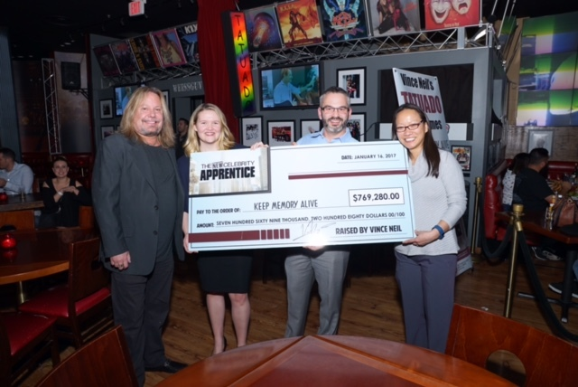Vince Neil, left, presents a check to Keep Memory Alive on Monday, Jan. 16, 2017, at his restaurant Tatuado at Circus Circus in Las Vegas. (Dawn Russi)