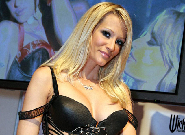 Adult film actress Tasha Reign attends the 2014 AVN Adult