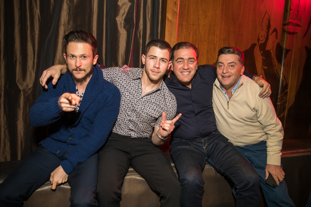 Nick Jonas, second from left, attends the Altec Lansing party at Boom Box Room at Marquee at The Cosmopolitan of Las Vegas on Thursday, Jan. 5, 2017, during CES. Jonathan Tucker is at left. (Globa ...