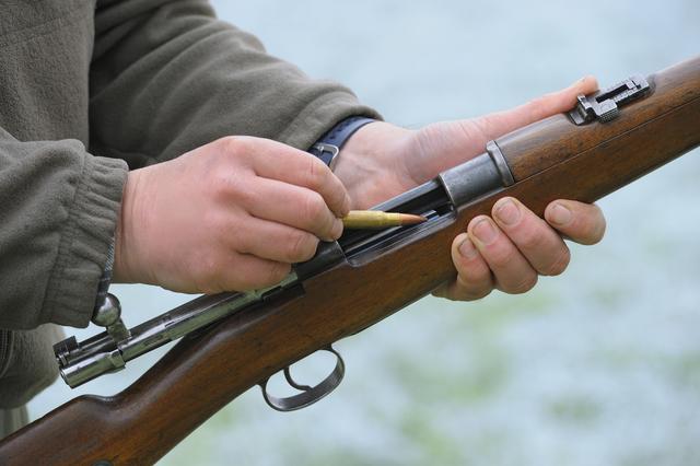 Man loading rifle (Thinkstock)