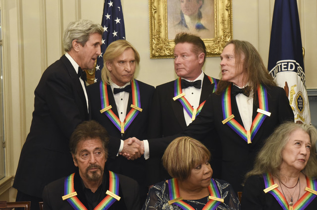 Secretary of State John Kerry, top left, meets with Eagles members Tim Schmit, right, Don Henley, second right, and Joe Walsh, second left, all 2016 Kennedy Center Honorees following the State Dep ...