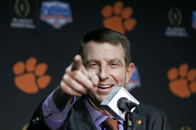Clemson head coach Dabo Swinney speaks to the media after arriving with his team at Phoenix Sky Harbor Airport on Monday Dec. 26, 2016, in Phoenix. Clemson will play Ohio State in the Fiesta Bowl  ...