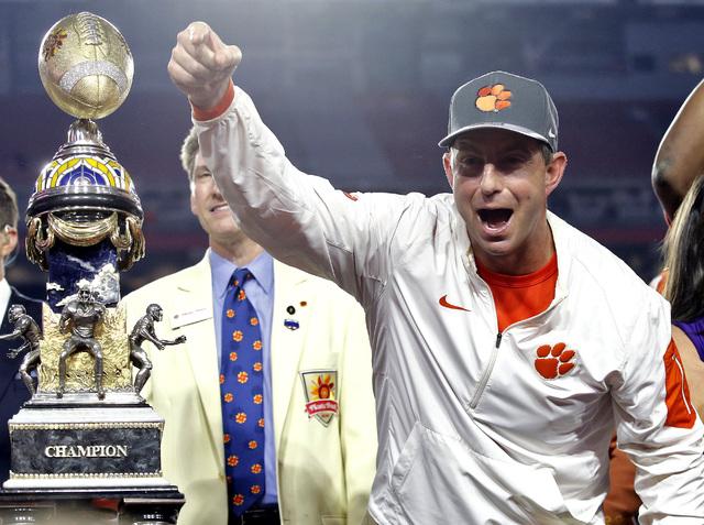 Clemson coach Dabo Swinney celebrates after the team's Fiesta Bowl NCAA college football playoff semifianl against Ohio State, Saturday, Dec. 31, 2016, in Glendale, Ariz. Clemson won 31-0 to advan ...