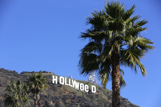 "The Hollywood sign is seen vandalized Sunday, Jan. 1, 2017. Los Angeles residents awoke New Year's Day to find a prankster had altered the famed Hollywood sign to read ""HOLLYWeeD."" (Damian Dovarga ..."