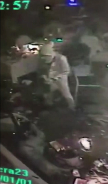 An attacker carrying a gun walks in the nightclub in Istanbul, early Sunday, Jan. 1, 2017. An assailant opened fire at a crowded nightclub in Istanbul during New Year's celebrations, killing dozen ...