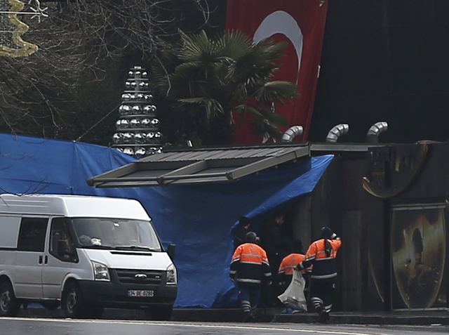 Turkish police officers work at the scene of an attack in Istanbul, Sunday, Jan. 1, 2017. An assailant believed to have been dressed in a Santa Claus costume opened fire at a crowded nightclub in  ...