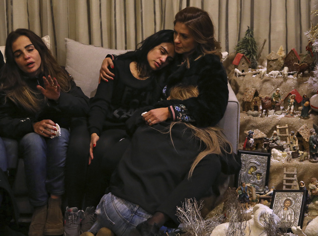 Sisters of Elias Wardini, a Lebanese man who was killed in the overnight Istanbul attack, mourn at their house, In Beirut, Lebanon, Sunday Jan. 1, 2017. Charbel Wardini told The Associated Press o ...