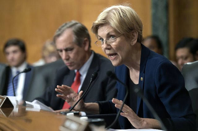 Senate Banking Committee member Sen. Elizabeth Warren, D-Mass., questions Wells Fargo Chief Executive Officer John Stumpf Sept. 20, 2016, on Capitol Hill in Washington. Warren is leading a new eff ...
