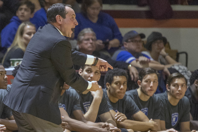 Duke head coach Mike Krzyzewski yells to his players during the first half of an NCAA college basketball game Saturday, Dec 31, 2016, at Cassell Coliseum in Blacksburg, Va. Tech won 89-75. (AP Pho ...
