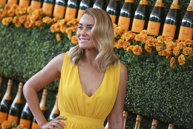 In this Oct. 17, 2015, file photo, Lauren Conrad arrives at the Veuve Clicquot Polo Classic at Will Rogers State Historic Park in Pacific Palisades, Calif. Conrad announced that she was expecting  ...