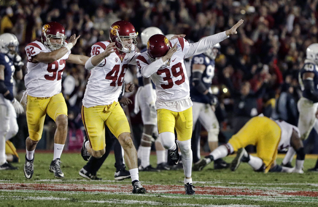 Southern California place kicker Matt Boermeester celebrates after kicking the game winning field goal against Penn State during the second half of the Rose Bowl NCAA college football game Monday, ...
