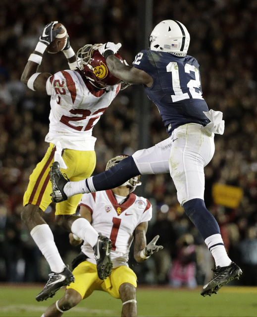 Southern California defensive back Leon McQuay III intercepts a pass intended for Penn State cornerback Jordan Smith during the second half of the Rose Bowl NCAA college football game Monday, Jan. ...