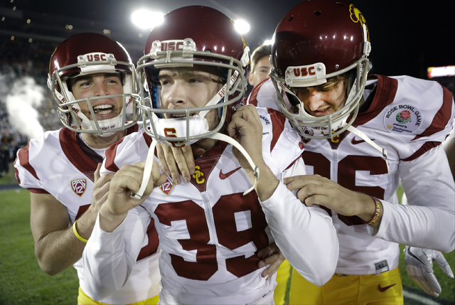 Southern California place kicker Matt Boermeester, middle, celebrates after the game winning field goal against Penn State during the second half of the Rose Bowl NCAA college football game Monday ...