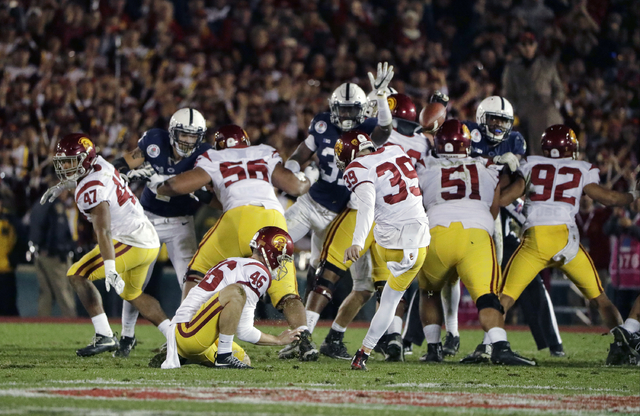 Southern California place kicker Matt Boermeester kicks the game winning field goal against Penn State during the second half of the Rose Bowl NCAA college football game Monday, Jan. 2, 2017, in P ...