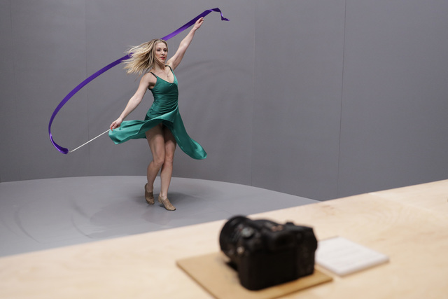 A dancer performs in front of Sony Alpha a99 II DSLR cameras during a news conference at CES International Wednesday, Jan. 4, 2017, in Las Vegas. (AP Photo/Jae C. Hong)