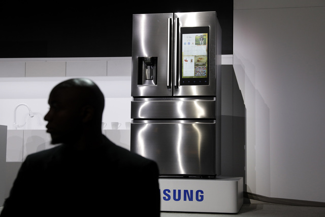 A refrigerator with Family Hub 2.0 is on display during a Samsung news conference before CES International, Wednesday, Jan. 4, 2017, in Las Vegas. Family Hub 2.0 features an interface on the refri ...