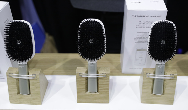 Hair Coach smart hairbrushes are displayed at the Withings booth during CES Unveiled before CES International, Tuesday, Jan. 3, 2017, in Las Vegas. The brush uses sensors to track hair damage and  ...
