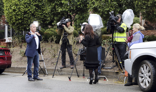 Journalists stand outside the homes of Debbie Reynolds and her daughter Carrie Fisher in Los Angeles, Thursday, Jan. 5, 2017.  Reynolds died Dec. 28 at the age of 84, a day after her daughter died ...