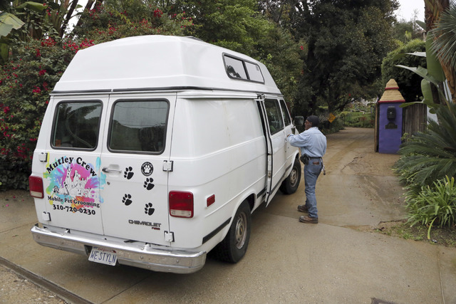 A dog grooming van arrives at the homes of Debbie Reynolds and her daughter Carrie Fisher in Los Angeles, Thursday, Jan. 5, 2017.  Reynolds died Dec. 28 at the age of 84, a day after her daughter  ...