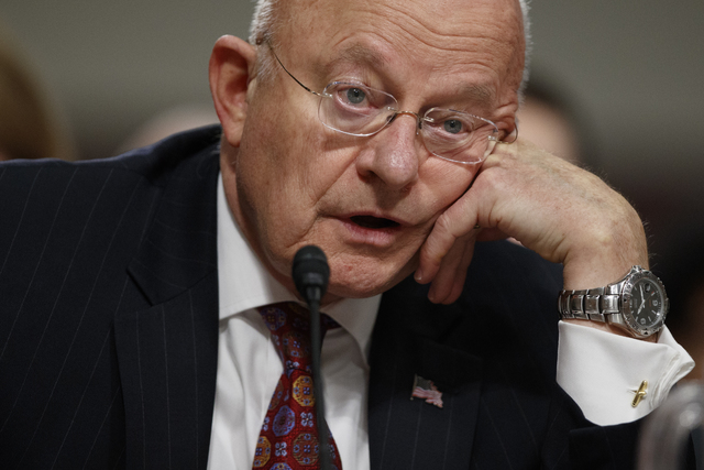 """Director of National Intelligence James Clapper testifies on Capitol Hill in Washington, Thursday, Jan. 5, 2017, before the Senate Armed Services Committee hearing: """"Foreign Cyber Threats ..."""