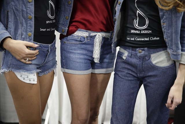 Models wear jeans from Spinali Designs at CES International Friday, Jan. 6, 2017, in Las Vegas. The $100 jeans will vibrate on your right or left hip to let you know which direction you should hea ...