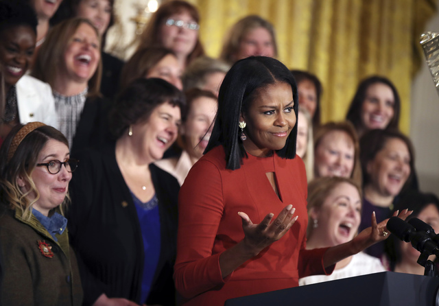 Michelle Obama gestures as she gives her final speech as First Lady at the 2017 School Counselor of the Year ceremony in the East Room of the White House in Washington, Friday, Jan. 6, 2017. (Manu ...