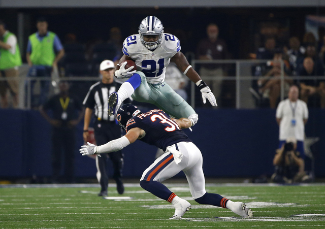 In this Sept. 25, 2016, file photo, Dallas Cowboys running back Ezekiel Elliott (21) leaps over a tackle attempt by Chicago Bears' Chris Prosinski (31) in the second half of an NFL football game,  ...