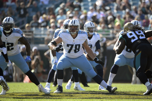 In this Dec. 24, 2016, file photo, Tennessee Titans offensive tackle Jack Conklin (78) block against the Jacksonville Jaguars defense during the first half of an NFL football game, in Jacksonville ...