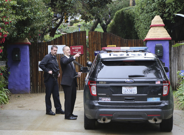 Los Angeles police officers and private security appear outside the homes of Debbie Reynolds and her daughter Carrie Fisher in Los Angeles Thursday, Jan. 5, 2017. Reynolds died Dec. 28 at the age  ...