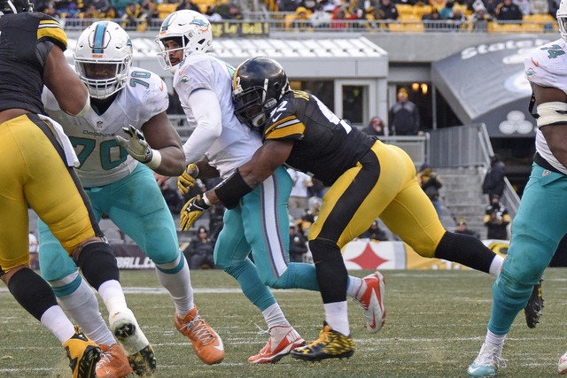Pittsburgh Steelers outside linebacker James Harrison (92) sacks Miami Dolphins quarterback Matt Moore (8), forcing a fumble that was recovered by the Steelers, during the first half of an AFC wil ...
