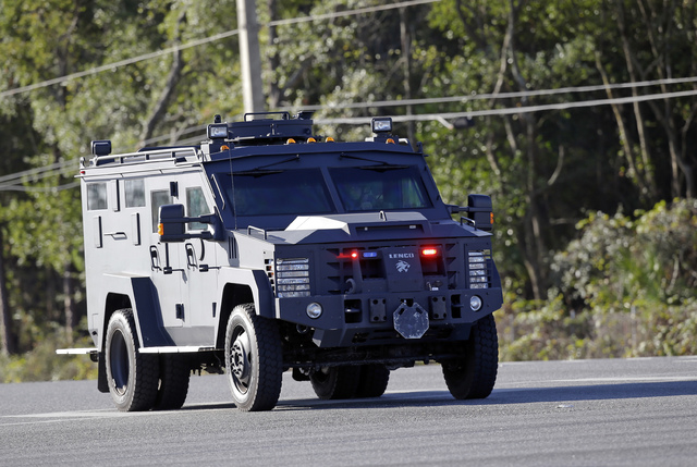 A law enforcement vehicle drives near a Walmart where a police officer was shot, Monday, Jan. 9, 2017, in Orlando, Fla. (John Raoux/AP)