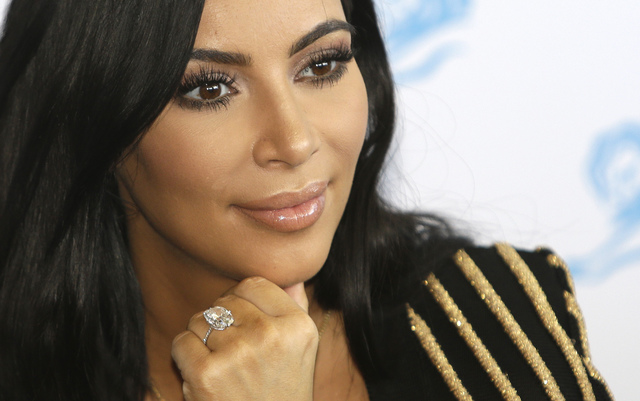 American TV personality Kim Kardashian attends the Cannes Lions 2015, International Advertising Festival in Cannes, southern France on June 24, 2015. Paris police said Monday, Jan. 9, 2017, that 1 ...
