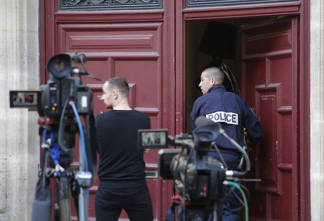 A French police officer enters the residence of Kim Kardashian West in Paris on Oct. 3, 2016. Paris police said  Monday, Jan. 9, 2017, 17 people have been arrested over Kim Kardashian jewelry heis ...