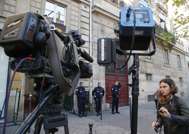 French police officers and a TV crew stand outside the residence of Kim Kardashian West in Paris on Oct. 3, 2016. Police in Paris say Monday, Jan. 9, 2017, that 17 people have been arrested in con ...