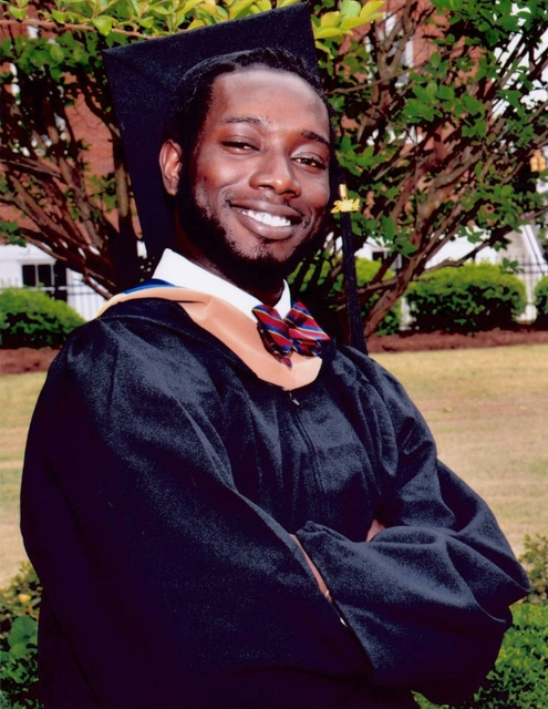 In this undated file photo made available by Anita Brewer Dantzler shows Tywanza Sanders on the day of his graduation from Allen University in Columbia, SC. Sanders was killed by Dylann Roof while ...