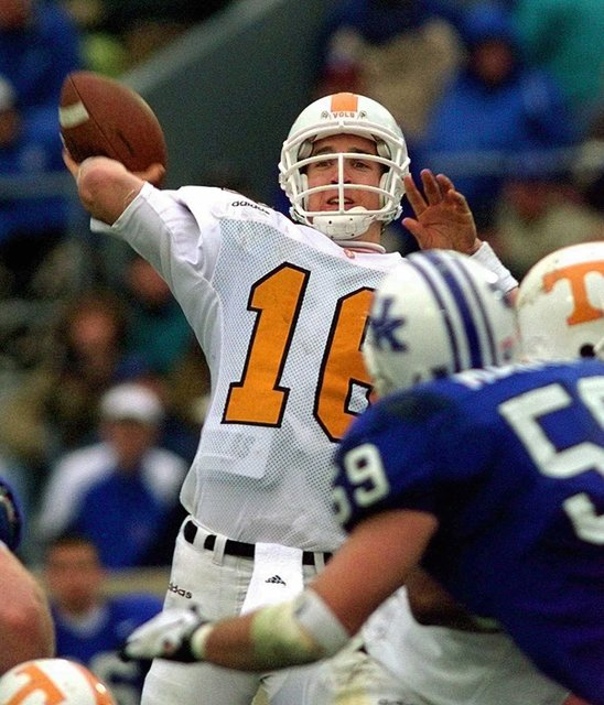 In this Nov. 22, 1997, file photo, Tennessee quarterback Peyton Manning launches a pass during the second half of his team's 59-31 win over Kentucky in an NCAA college football game in Lexington,  ...