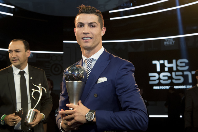 Cristiano Ronaldo of Portugal poses with the trophy after winning for The Best FIFA Men's Player award during the The Best FIFA Football Awards 2016 ceremony held at the Swiss TV studio in Zurich, ...