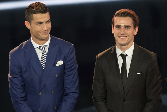 Cristiano Ronaldo, left, of Portugal and Antoine Griezmann of France smile on the stage during the The Best FIFA Football Awards 2016 ceremony held at the Swiss TV studio in Zurich, Switzerland, M ...