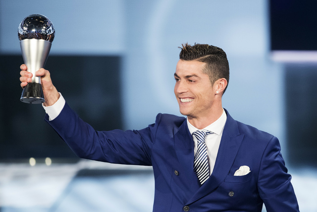 Cristiano Ronaldo of Portugal poses with the trophy after winning The Best FIFA Men's Player award during the The Best FIFA Football Awards 2016 ceremony held at the Swiss TV studio in Zurich, Swi ...