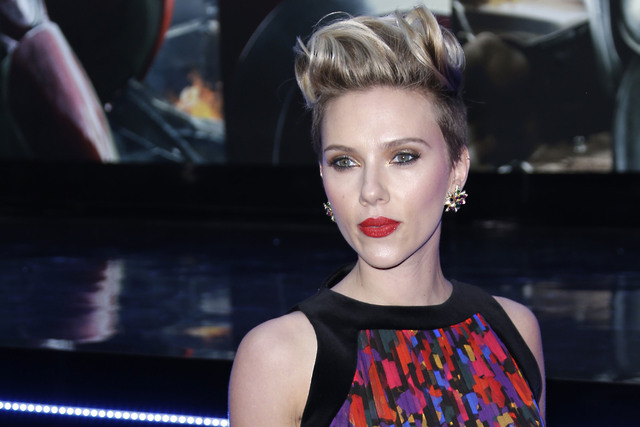 In this April 21, 2015, file photo, Scarlett Johansson poses for photographers in London. Hollywood will be turning out in force for the women's march on Washington set to follow Donald Trump' ...