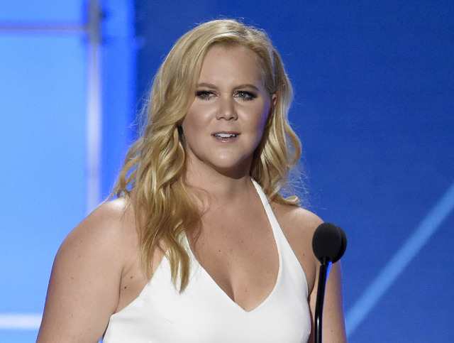In this Jan. 17, 2016 file photo, Amy Schumer is seen in Santa Monica, Calif. Hollywood will be turning out in force for the women's march on Washington set to follow Donald Trump's inaugurati ...