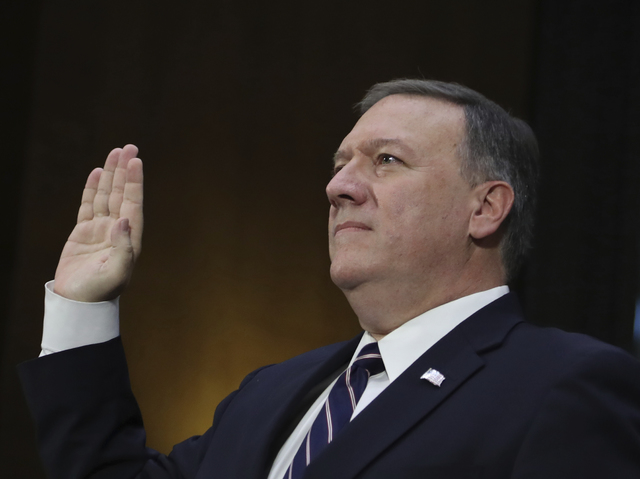 CIA Director-designate Rep. Michael Pompeo, R-Kan. is sworn in on Capitol Hill in Washington, Thursday, Jan. 1, 2017, prior to testifying at his confirmation hearing before the Senate Intelligence ...