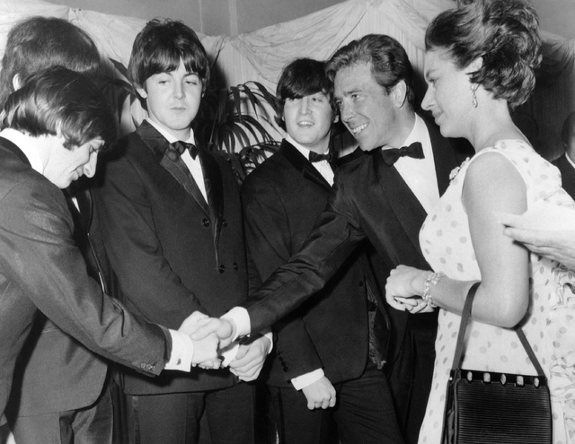 Britain's Princess Margaret with Lord Snowdon, Antony Armstrong Jones, second left, as he shakes hands with Ringo Starr when meeting the Beatles before the world charity premiere of their second f ...
