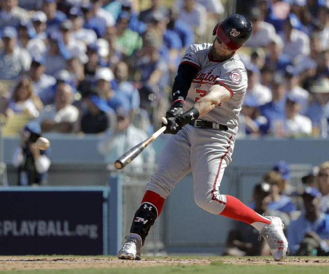 In this photo taken Oct. 10, 2016, Washington Nationals' Bryce Harper hits a RBI-single during the third inning in Game 3 of baseball's National League Division Series against the Los Angeles Dodg ...